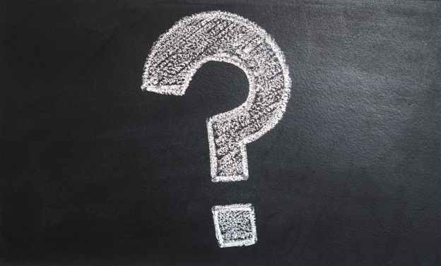 a drawing of a question mark on a chalkboard