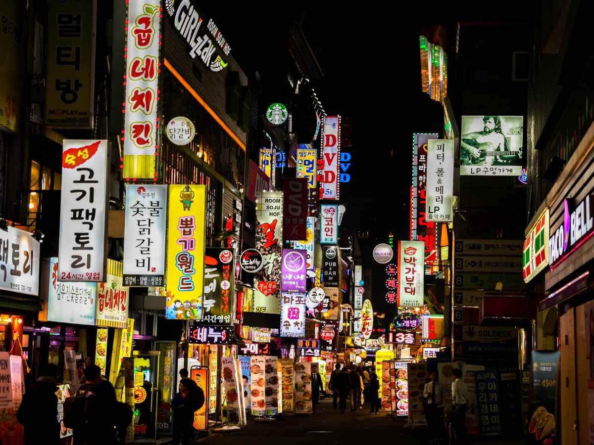 Korean signs lighting up a dark street