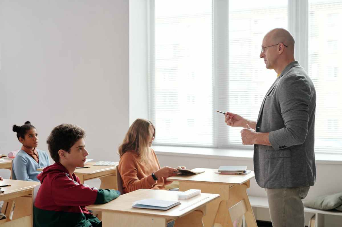 a teacher speaking to his class